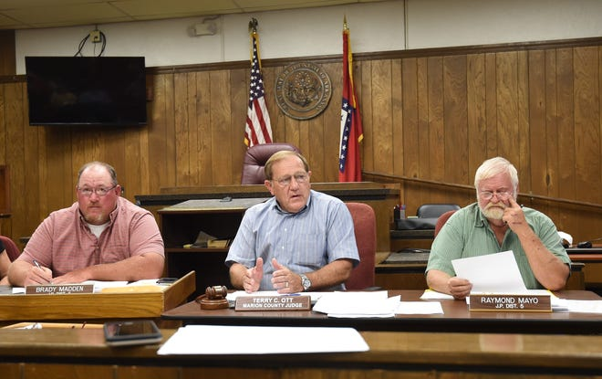 County Judge Terry Ott (center) talks about Marion County's 911 system Tuesday night at the Marion County Quorum Court meeting. Flanking the judge are justices of the peace Brady Madden (left) and Raymond Mayo (right).