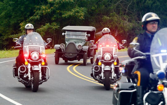 Former New Jersey Governor Chris Christie drives in a 1922 Franklin Model 10A to take an inaugural ride on his newly dedicated Gov. Chris Christie Drive, a new main access road to Central Park of Morris County. September 12, 2018, Morris Plains, NJ