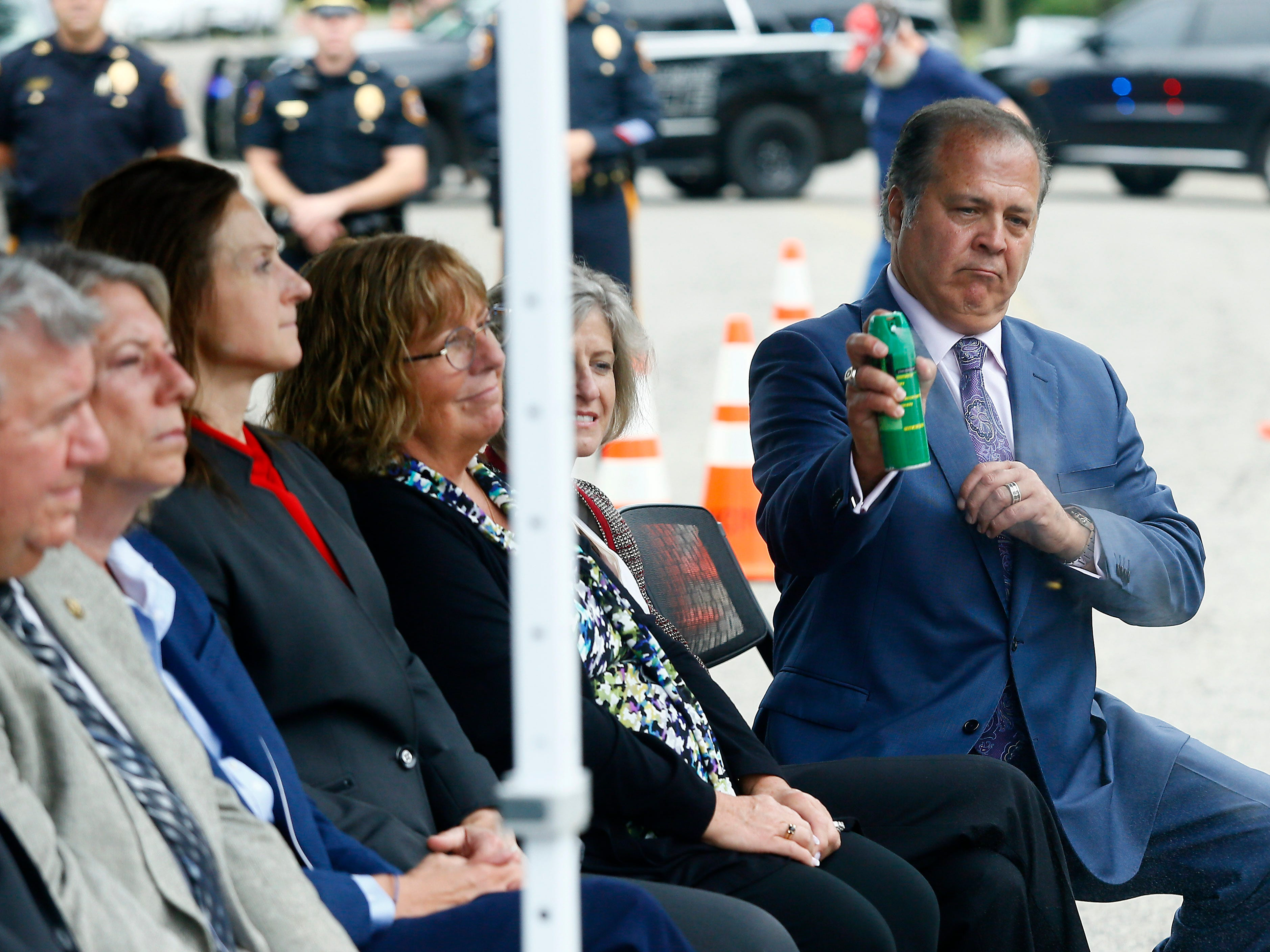 Freeholder Thomas J. Mastrangelo came prepared for a swarm of bees that showed up as Morris County freeholders formally open Gov. Chris Christie Drive, a new main access road to Central Park of Morris County. September 12, 2018, Morris Plains, NJ