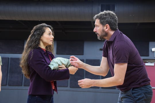 "Shelly (Andrea Morales, left) and Tilden (Anthony Marble) share a moment in ""Buried Child.""  Sam Shepherd's play, which mixes moments of stark drama with dark comedy, runs at the Shakespeare Theatre of NJ in Madison through October 7."