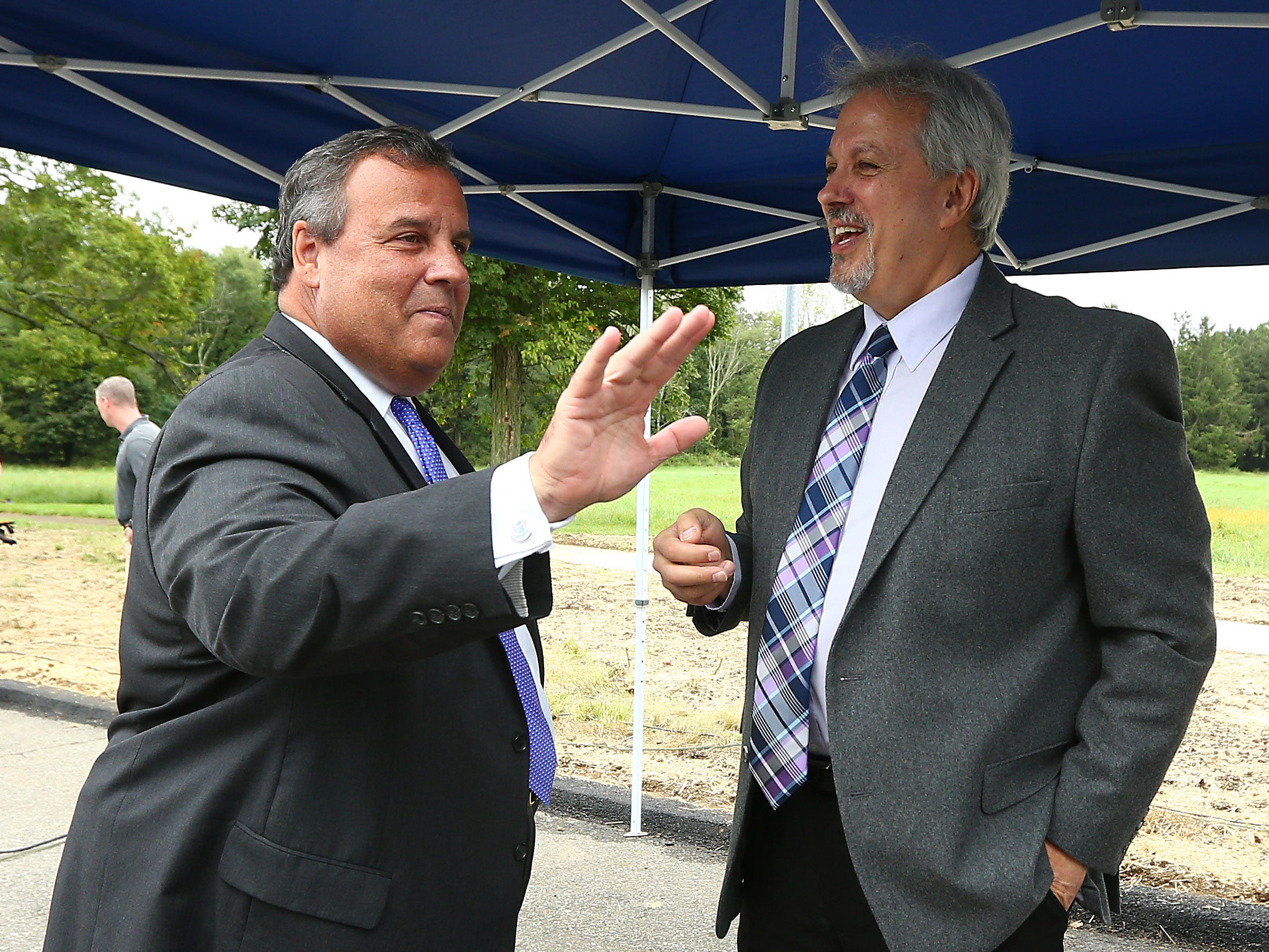 Former New Jersey Gov. Chris Christie, l, talks with Larry Ragonese, Morris County Communications Director as Morris County freeholders formally open Gov. Chris Christie Drive, a new main access road to Central Park of Morris County. September 12, 2018, Morris Plains, NJ