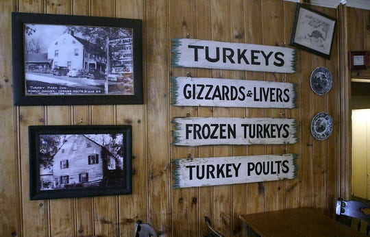 April 18, 2007 at the Puddingstone Inn, photos of the former Old Larson's Turkey Farm and signs hang on the wall.