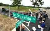 Former New Jersey Governor Chris Christie unveiled the street sign for Gov. Chris Christie Drive as Morris County freeholders formally open a new main access road to Central Park of Morris County.