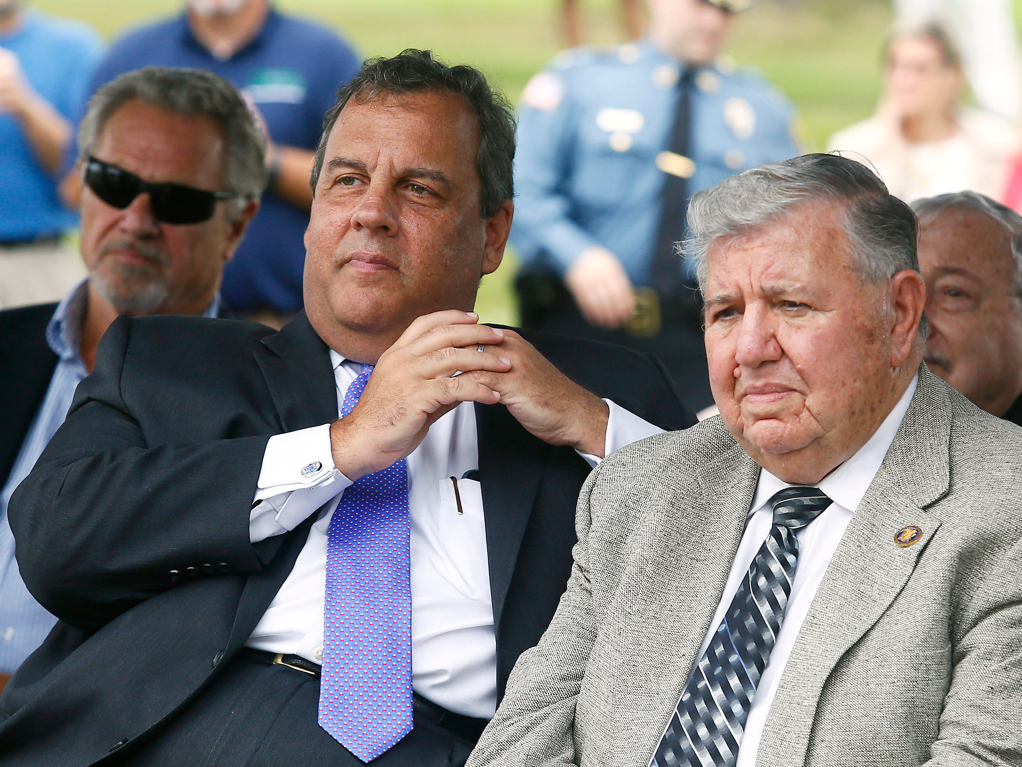Former New Jersey Governor Chris Christie sits with Senator Tony Bucco as Morris County freeholders formally open Gov. Chris Christie Drive, a new main access road to Central Park of Morris County. September 12, 2018, Morris Plains, NJ