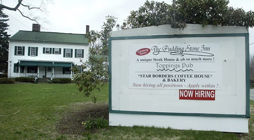 The Puddingstone Inn sign in 2007, another reopening of the old Larison's Turkey Farm.