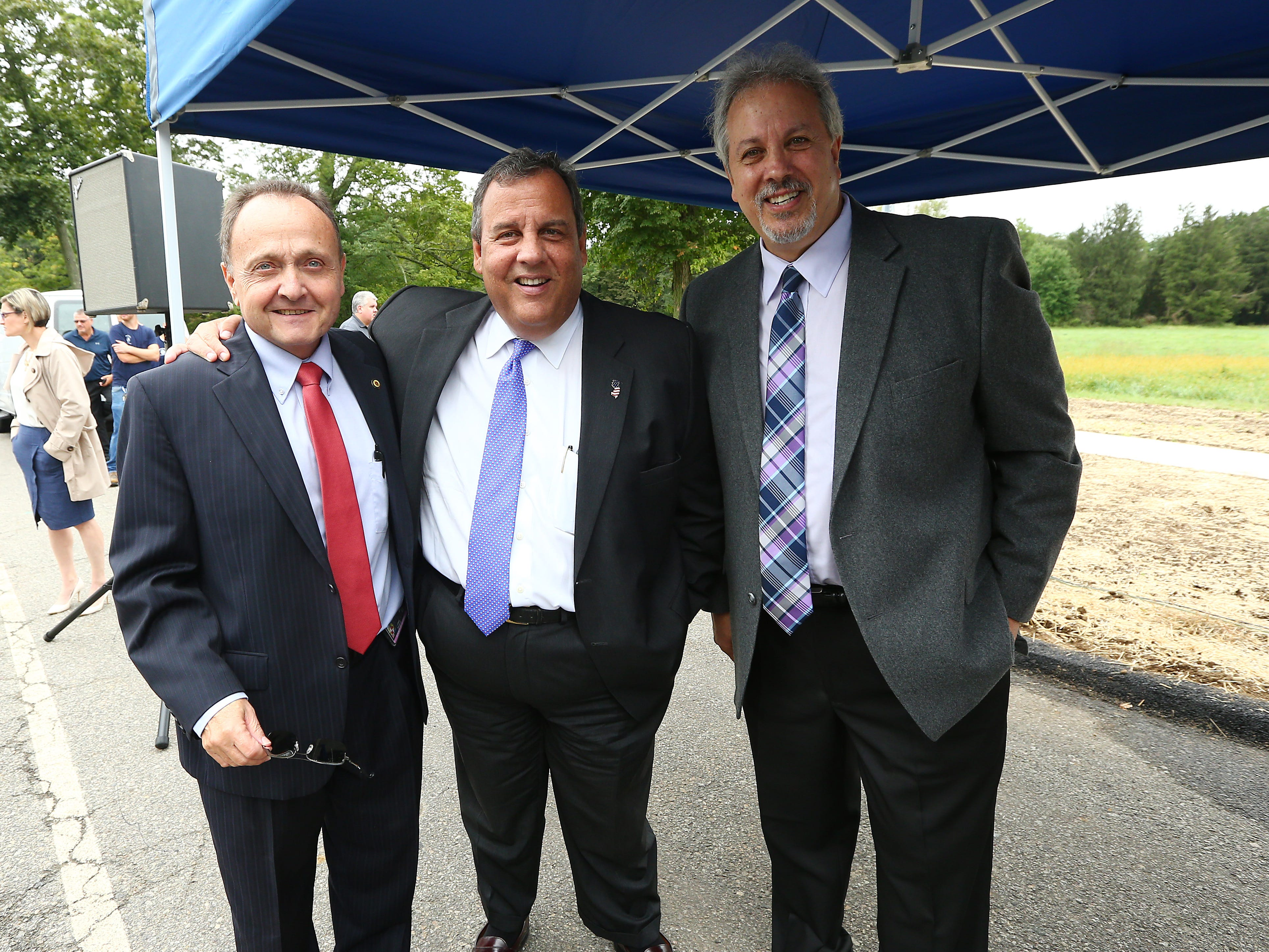 Morris County Administrator John Bonanni, l, with former NJ Gov. Chris Christie and  Larry Ragonese as Morris County freeholders formally open Gov. Chris Christie Drive, a new main access road to Central Park of Morris County. September 12, 2018, Morris Plains, NJ