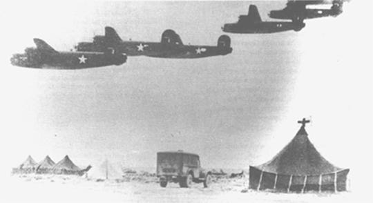 A formation of B-24 Liberators take off from their airfield near Benghazi, Libya, July 20, 1943. The Operation Tidal Wave attack force consisted of 178 B-24 Liberators, each with 10-man crews.