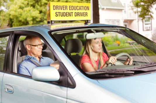 Nervous Teen Driver Taking Driving Examination With Examiner