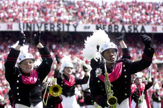 Members of the Troy State band perform on the field at halftime in Nebraska in 2001.