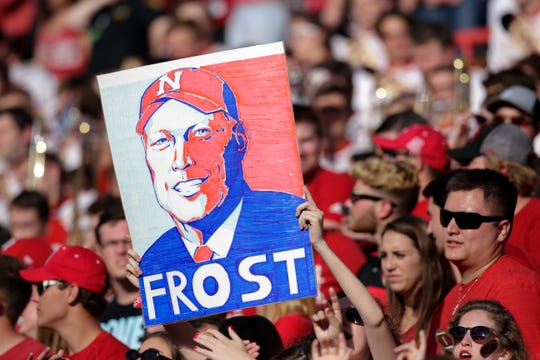 Fans hold up a poster of Nebraska head coach Scott Frost during the second half of an NCAA college football game against Colorado in Lincoln, Neb., Saturday, Sept. 8, 2018. Colorado won 33-28. (AP Photo/Nati Harnik)