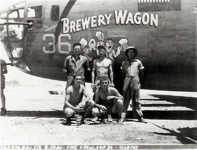 """The ground crew of the """"Brewery Wagon,"""" assigned to the 512th Bombardment Squadron 376th Bombardment Group, Libya, July 20, 1943. After dropping its bombs on its target, an antiaircraft shell hit the aircraft, killing two of its crewmen and causing the aircraft to crash. The remaining eight crewmen became prisoners of war."""