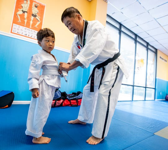 Taekwondo Master Yun Chung helps with a class at one of his Taekwondo schools in Montgomery, Ala., on Tuesday September 11, 2018.