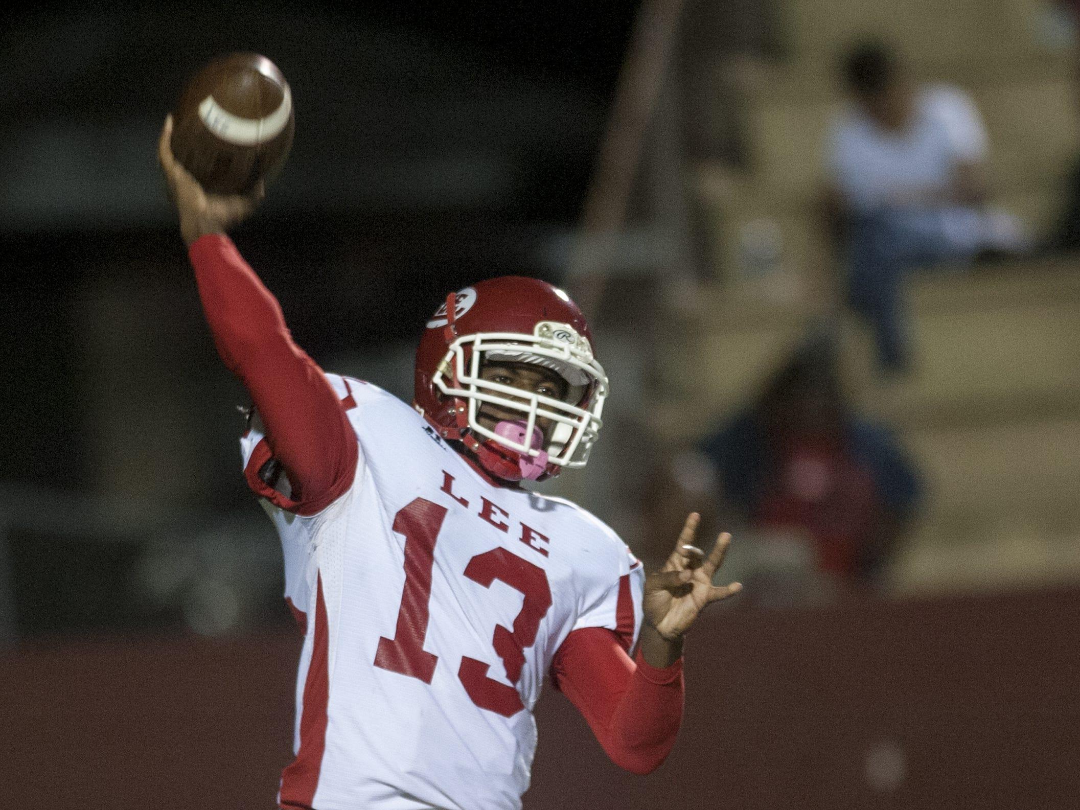 Lee quarterback Shaquille Johnson throws against Prattville at Stanley Jensen Stadium in Prattville, Ala. on Friday October 23, 2015.