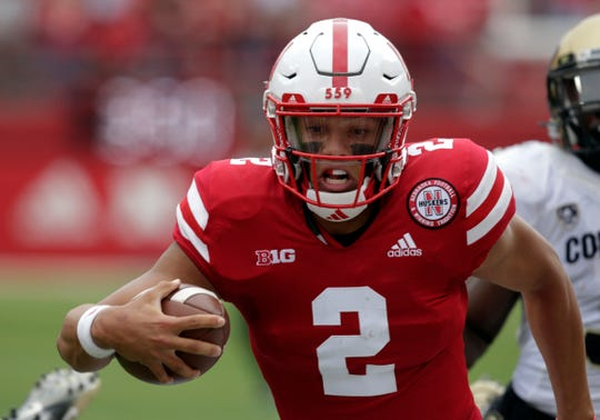 Nebraska quarterback Adrian Martinez (2) runs for a touchdown during the first half of an NCAA college football game against Colorado in Lincoln, Neb., Saturday, Sept. 8, 2018. (AP Photo/Nati Harnik)