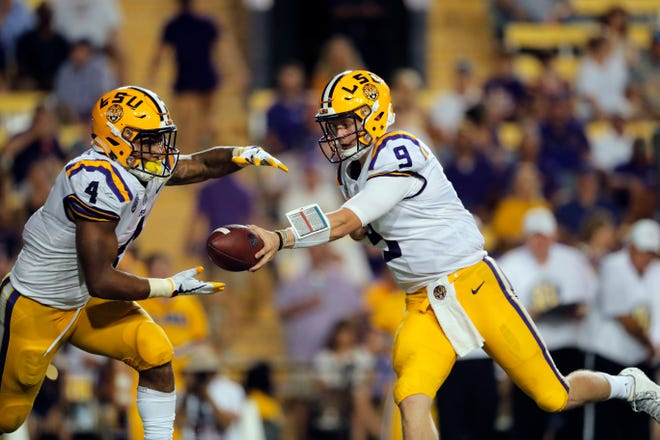 LSU quarterback Joe Burrow (9) hands off to running back Nick Brossette (4) in the second half against Southeastern Louisiana in Baton Rouge, La., Saturday, Sept. 8, 2018. LSU won 31-0.