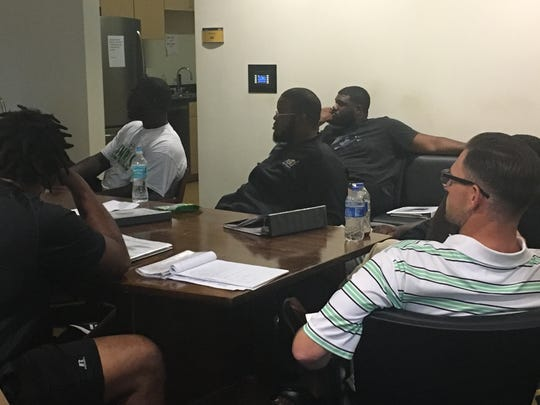 Alabama State offensive line coach Justin Keown goes through film of practice with his team.