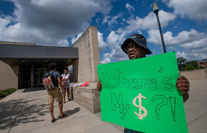 Alabama State University student Divonta Palmer protests problems in the financial aid offices on the ASU campus in Montgomery, Ala., on Wednesday September 12, 2018.