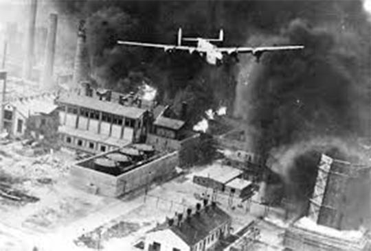 A B-24 Liberator over the oil refineries at Ploesti, Romania, after it dropped its bombs. Although the attack cost the Army Air Forces about 30 percent of the attacking aircraft and crewmembers, the damaged oil refineries were back in service three months later.