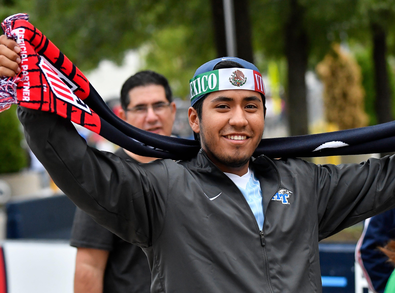 Soccer fan Edgar Marceleno prepares for the USA vs. Mexico soccer match at Nissan Stadium Tuesday, Sept. 11, 2018, in Nashville, Tenn.