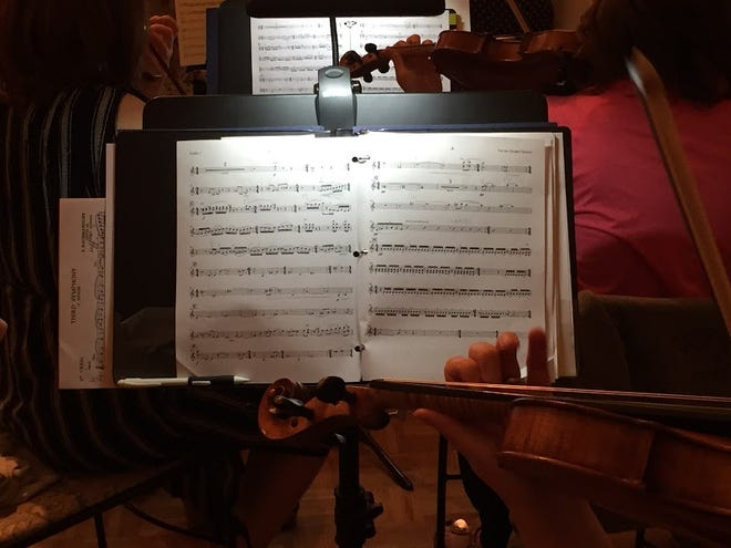 A Nashville Philharmonic violinist prepares for a part in a Tracy Silverman piece during rehearsal in September 2018.