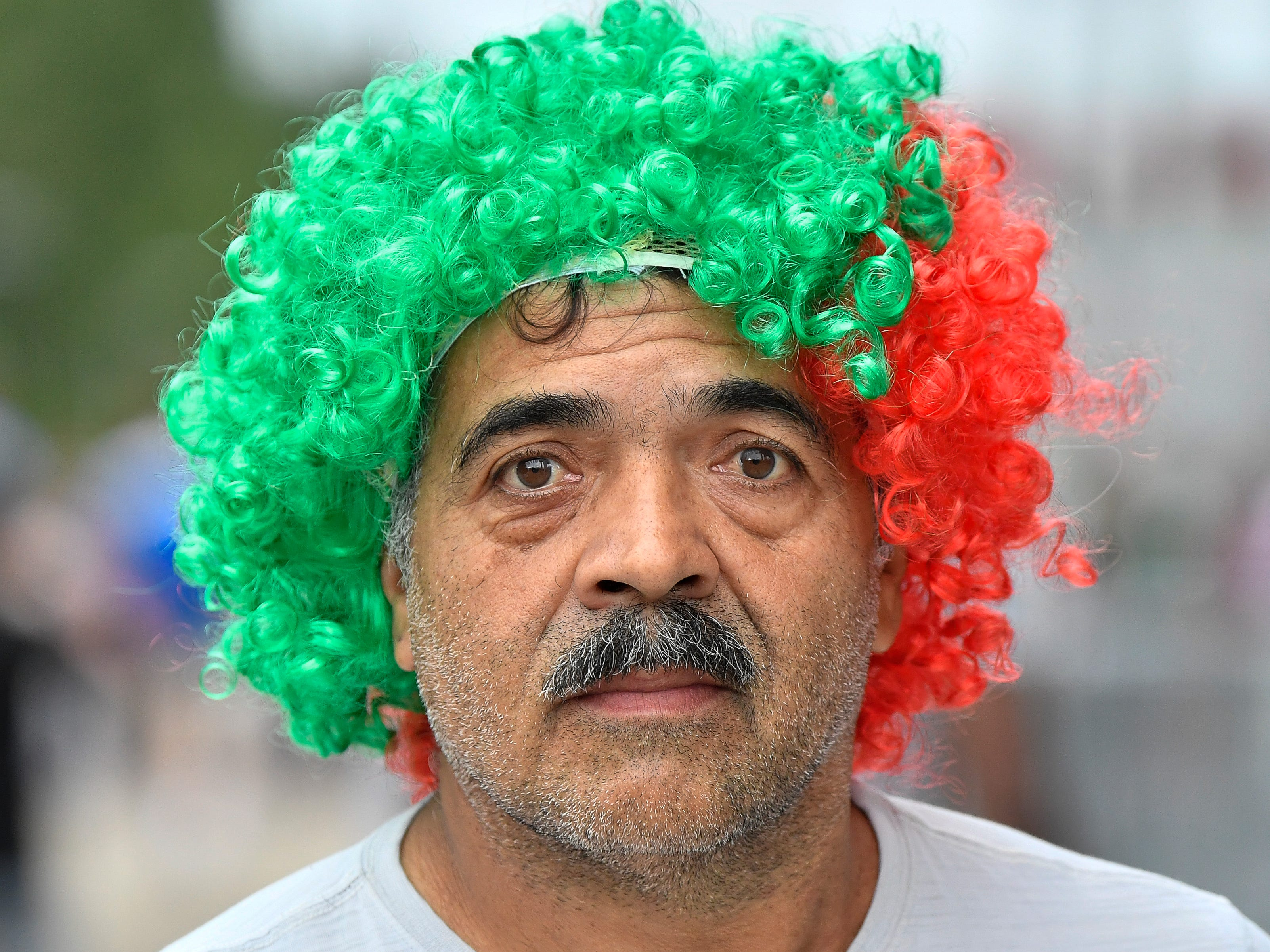 Mexican soccer fan Noe Nolasco wears his country's colors on his head before the USA vs. Mexico Soccer match at Nissan Stadium Tuesday, Sept. 11, 2018, in Nashville, Tenn.