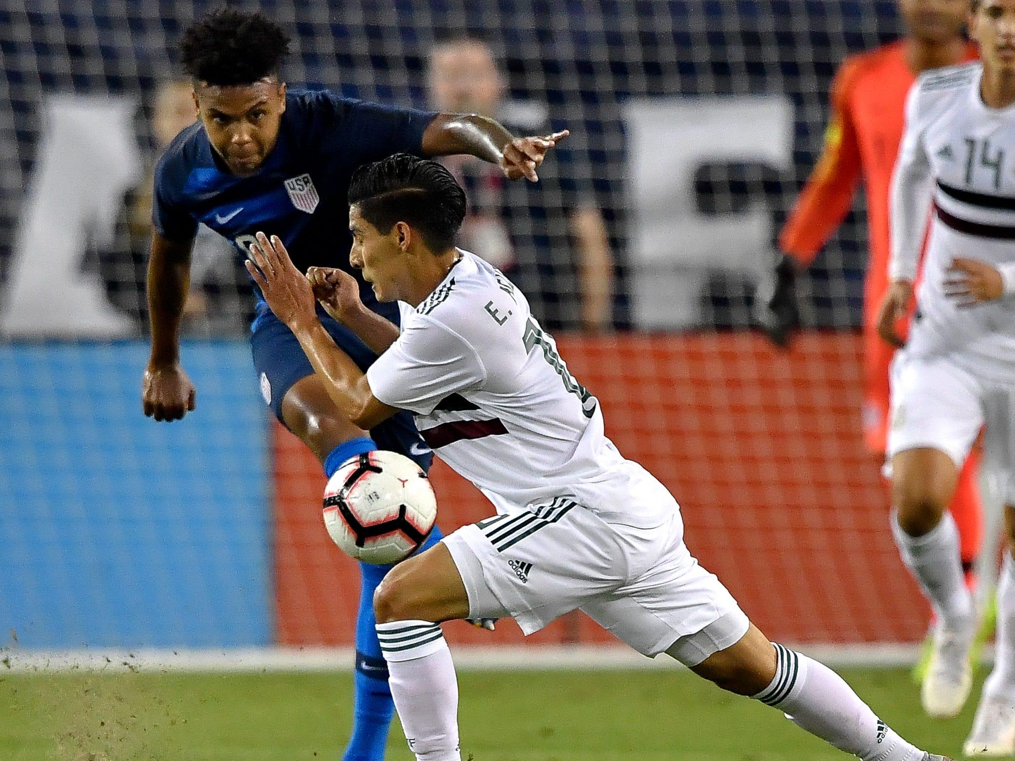 Mexico midfielder Erick Aguirre (16) defends against USA midfielder Weston McKennie (8) during the first half at Nissan Stadium in Nashville, Tenn., Tuesday, Sept. 11, 2018.