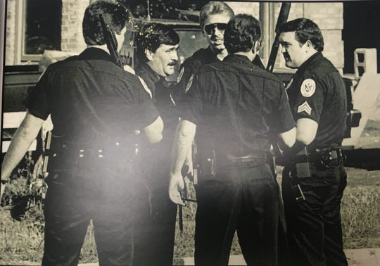 Brentwood police officers work the scene of a homicide in Belle Rive in 1986.