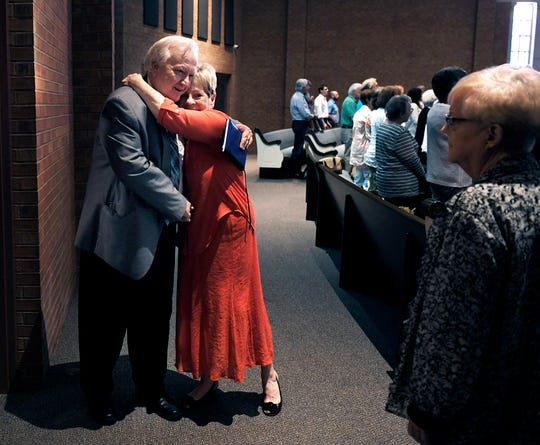 Minister Joey Spann is greeted by people at Bellevue Church of Christ on July 29, 2018, after Spann talked about what happened at Burnette Chapel Church of Christ when a gunman opened fire on his congregation. He's been visiting Churches of Christ to share his story.