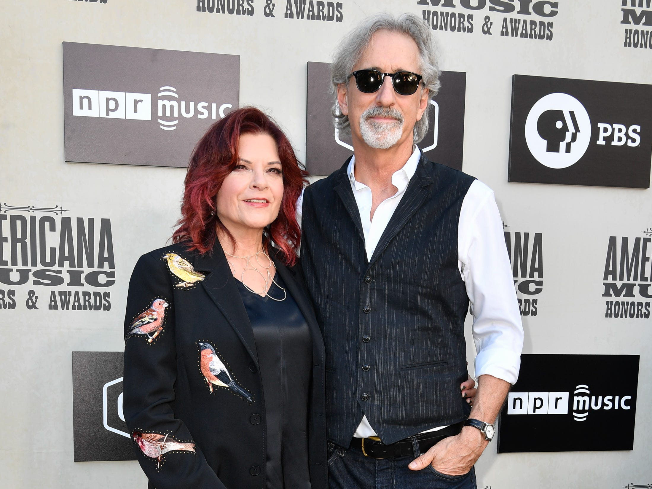 Rosanne Cash and John Leventhal pose on the red carpet before the 2018 Americana Honors and Awards show at the Ryman Auditorium in Nashville, Tenn., Wednesday, Sept. 12, 2018.