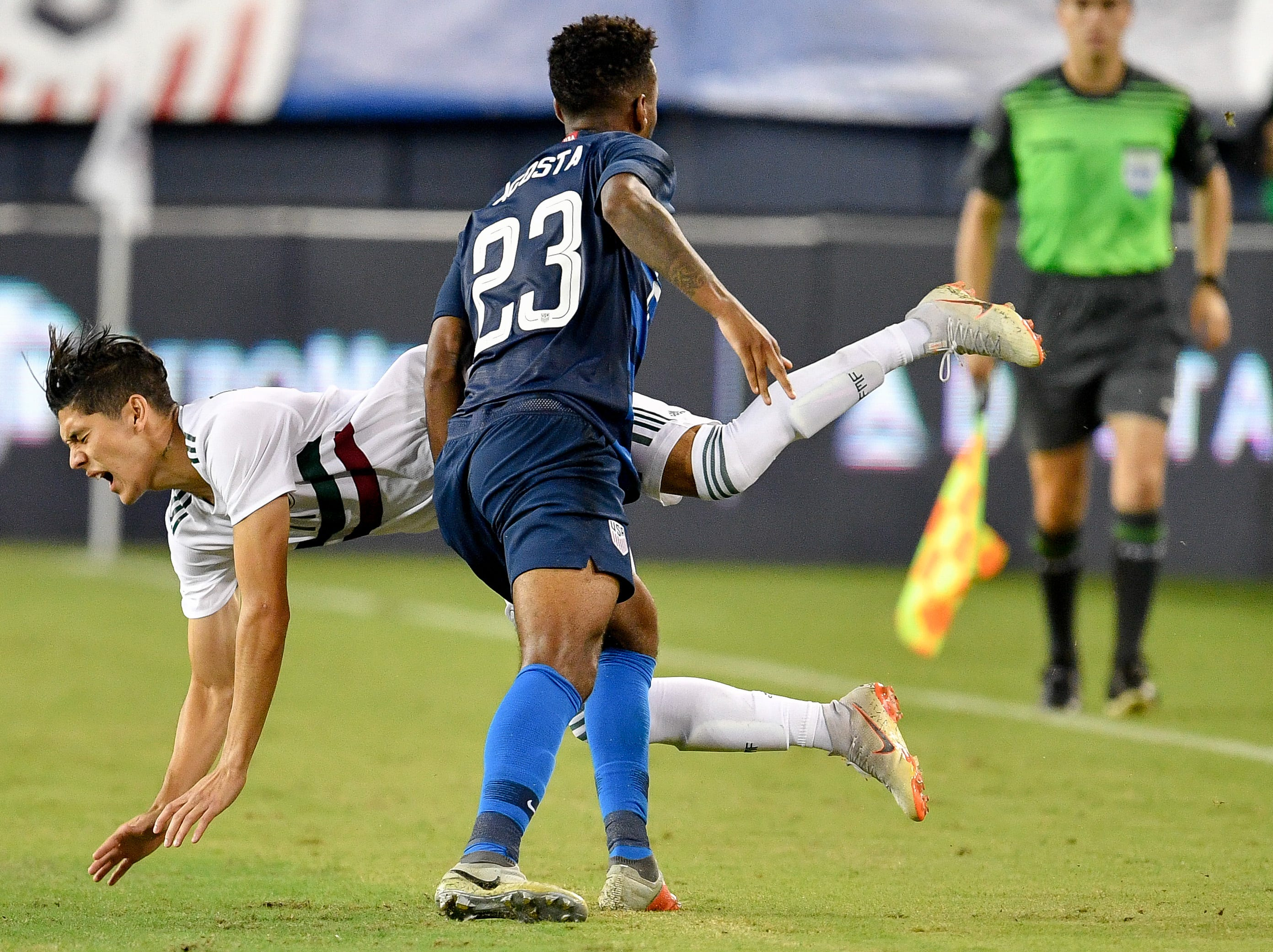 Mexico defender Gerardo Arteaga (17) collides with USA midfielder Kellyn Acosta (23)  during the second half at Nissan Stadium in Nashville, Tenn., Tuesday, Sept. 11, 2018.