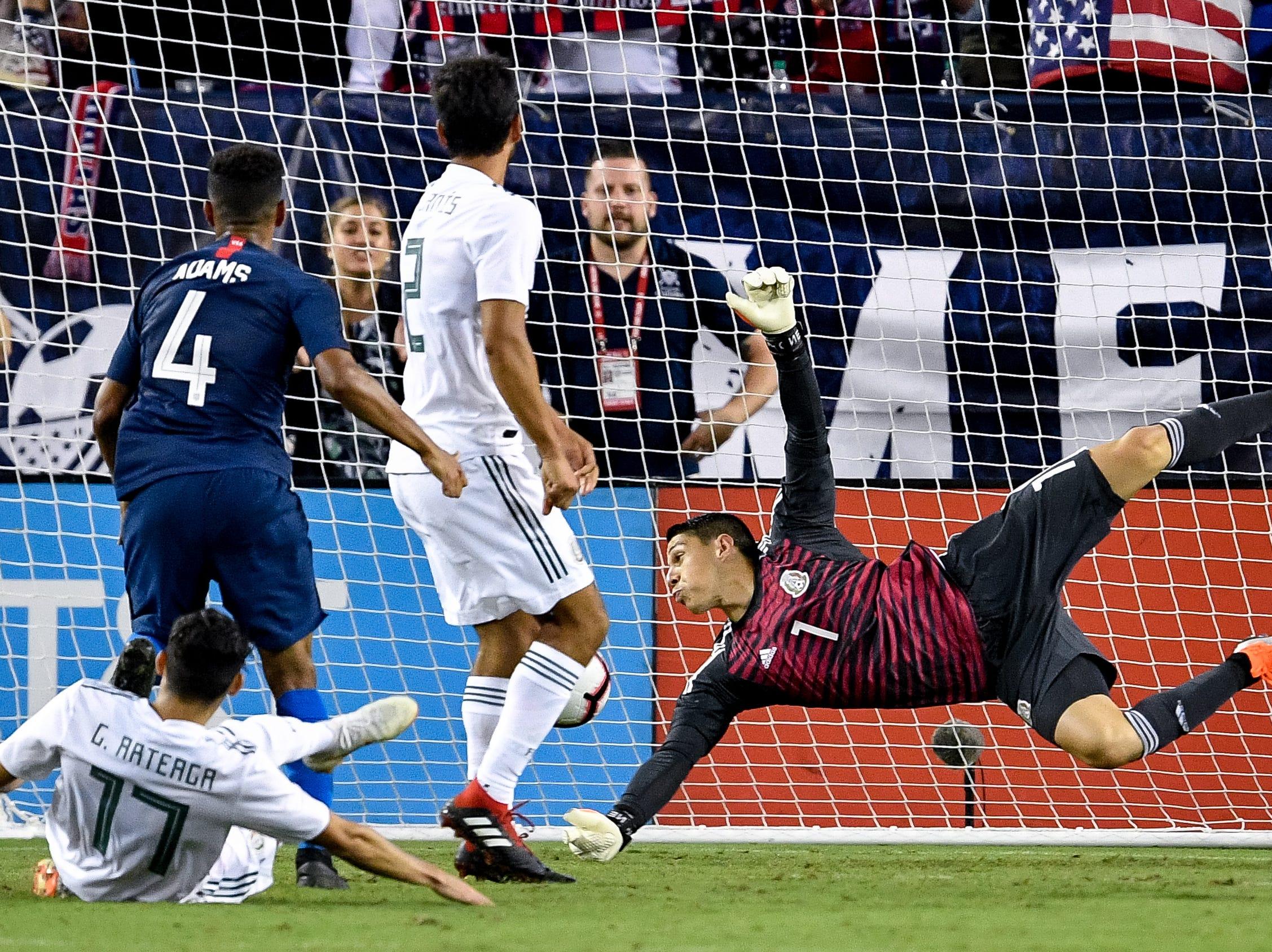 USA midfielder Tyler Adams (4) scores past Mexico goalkeeper Hugo Gonzalez (1) during the second half at Nissan Stadium in Nashville, Tenn., Tuesday, Sept. 11, 2018.