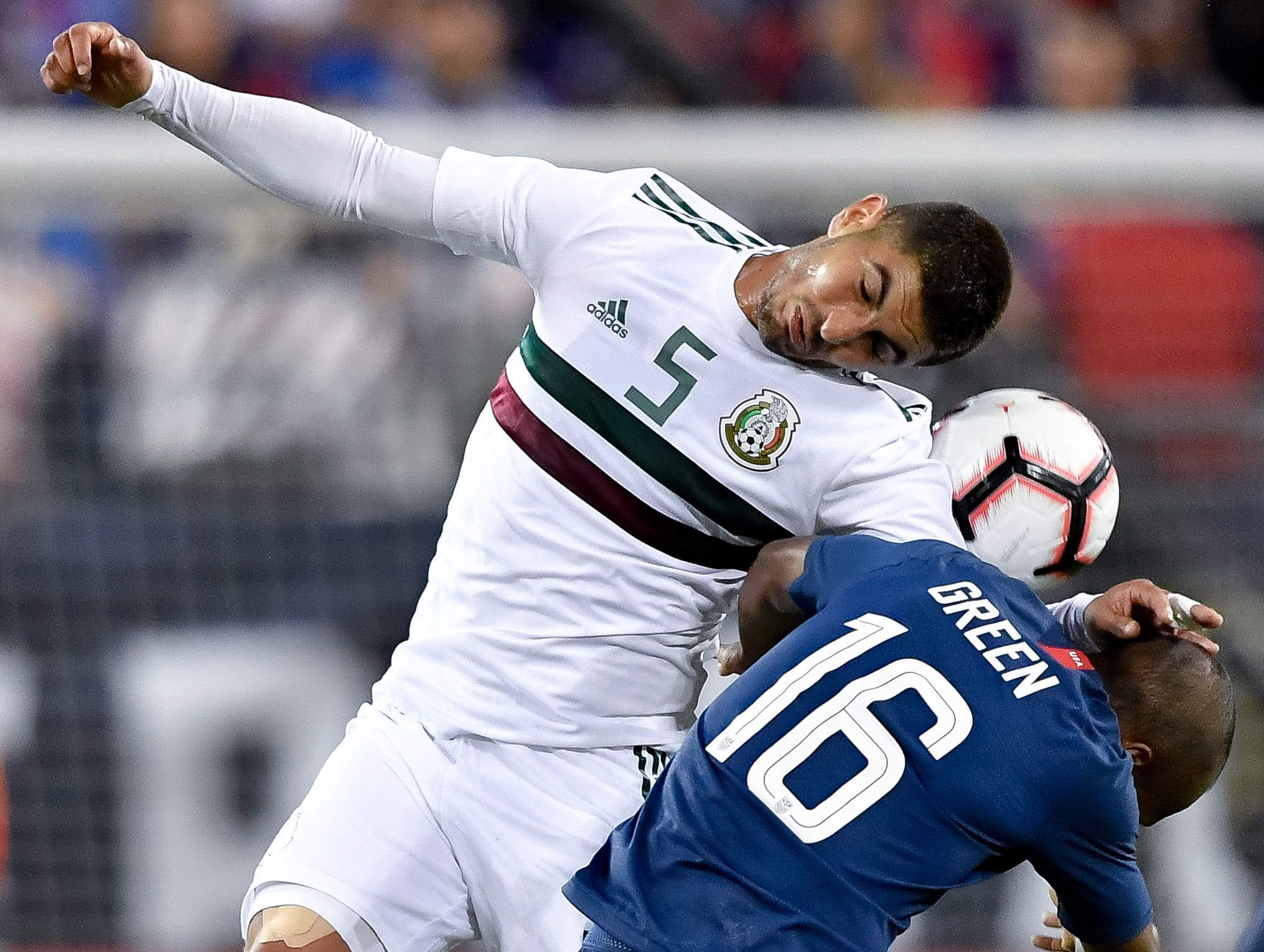 Mexico midfielder Victor Guzman (5) battles for the ball with USA midfielder Julian Green (16) during the first half at Nissan Stadium in Nashville, Tenn., Tuesday, Sept. 11, 2018.
