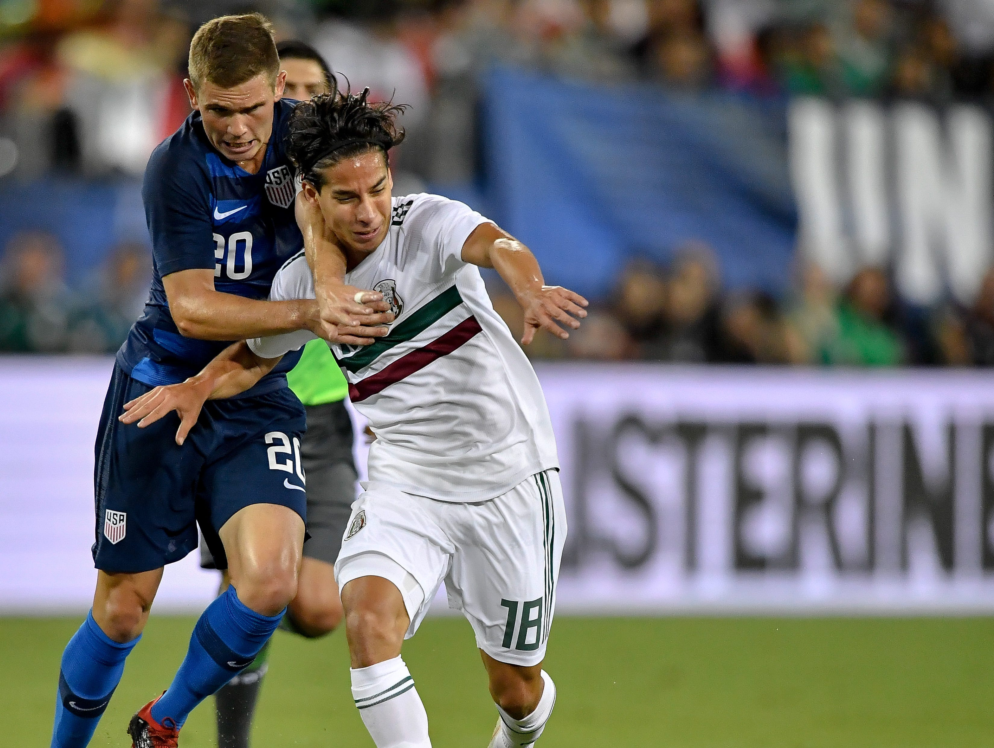 USA midfielder Wil Trapp (20) chases the ball with Mexico midfielder Diego Lainez (18) during the first half at Nissan Stadium in Nashville, Tenn., Tuesday, Sept. 11, 2018.