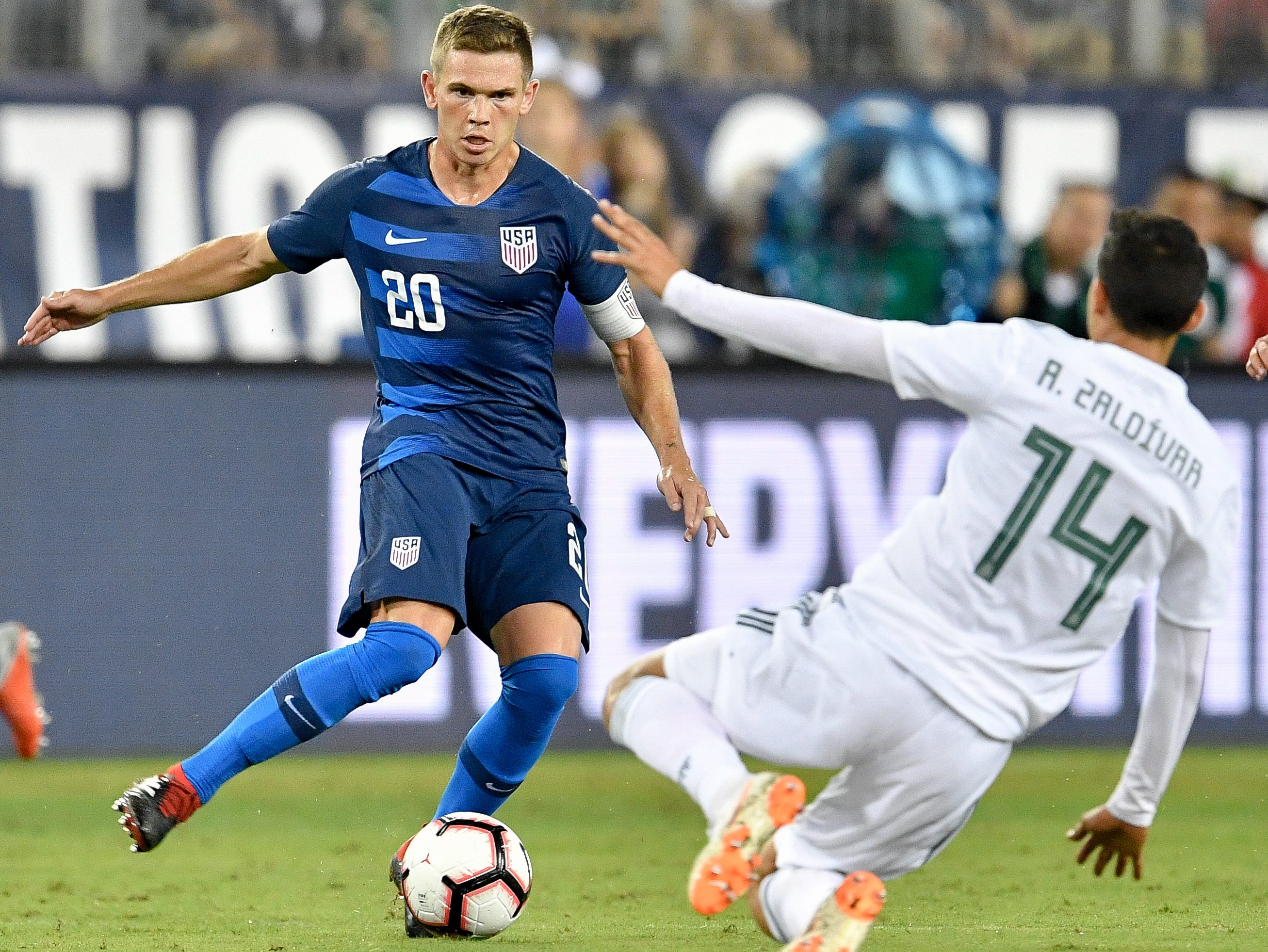 USA midfielder Wil Trapp (20) passes past Mexico forward Angel Zaldivar (14) during the second half at Nissan Stadium in Nashville, Tenn., Tuesday, Sept. 11, 2018.