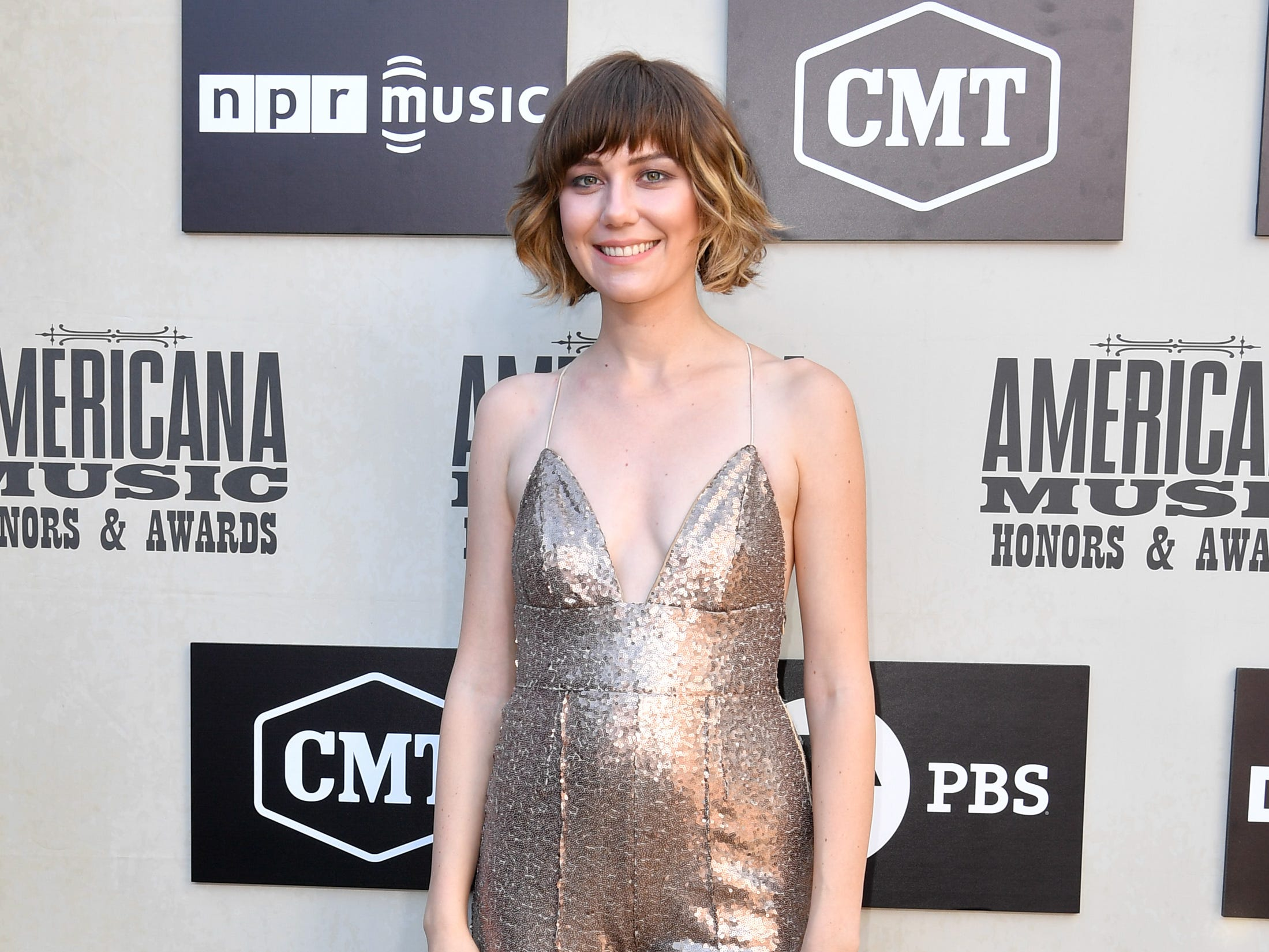 Molly Tuttle poses on the red carpet before the 2018 Americana Honors and Awards show at the Ryman Auditorium in Nashville, Tenn., Wednesday, Sept. 12, 2018.