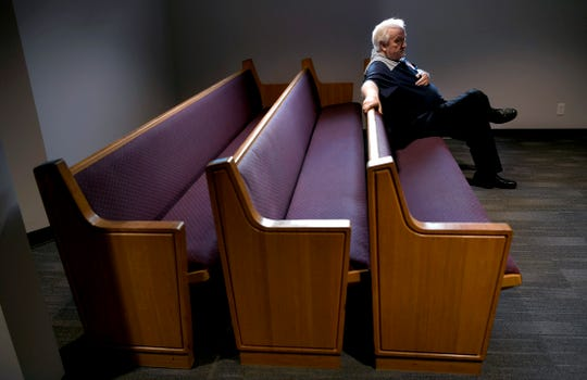 "Minister Joey Spann sits inside Burnette Chapel Church of Christ's sanctuary, where renovations are almost complete a year after a gunman opened fire on his congregation. ""We just want to make it easier on our members to come in,"" Spann said of the renovations. ""They come bravely anyway. We just want to make it better."""