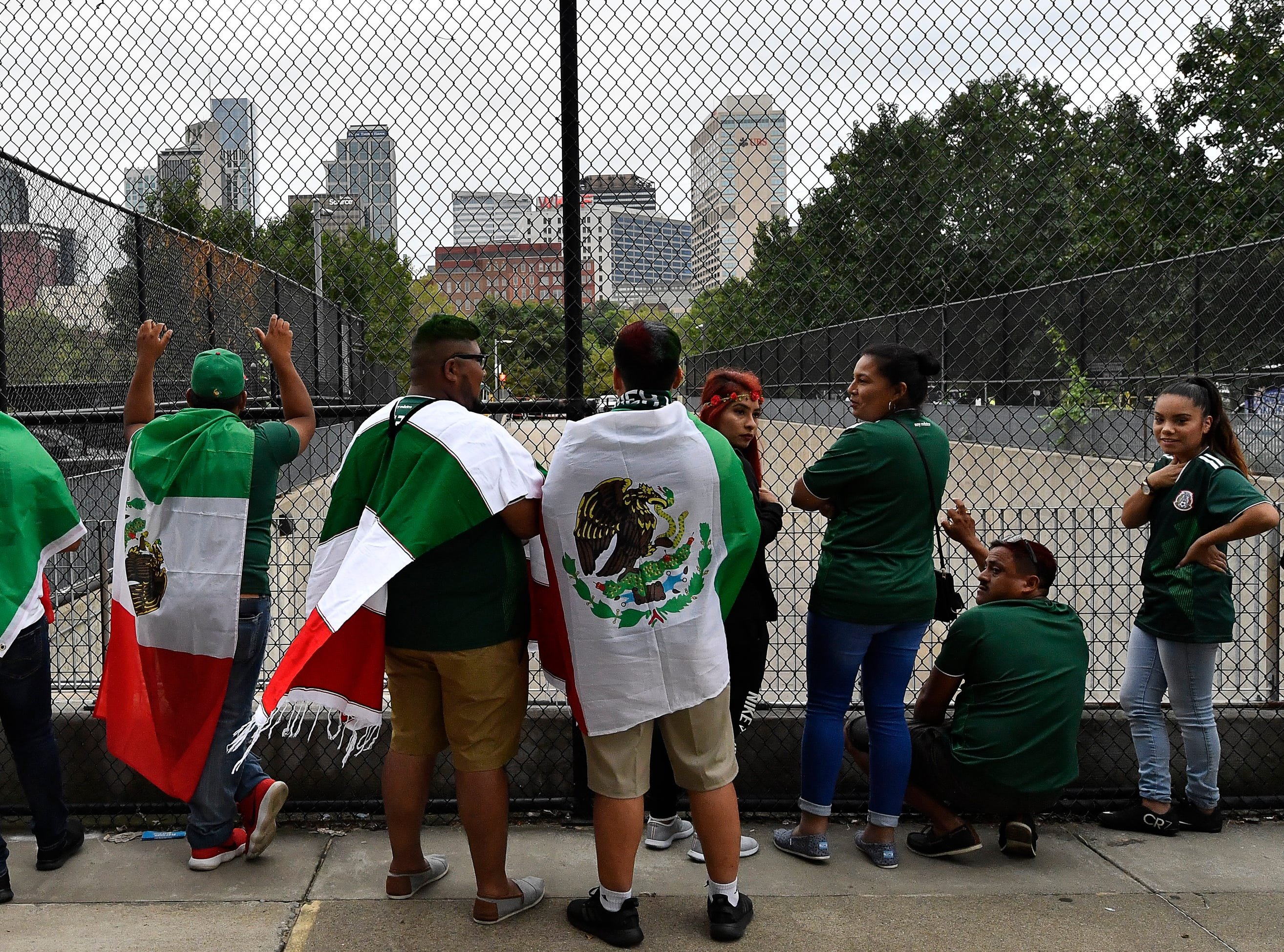 Mexican soccer fans wait for their team to arrive at Nissan Stadium before the soccer match between USA and MexicoTuesday, Sept. 11, 2018, in Nashville, Tenn.