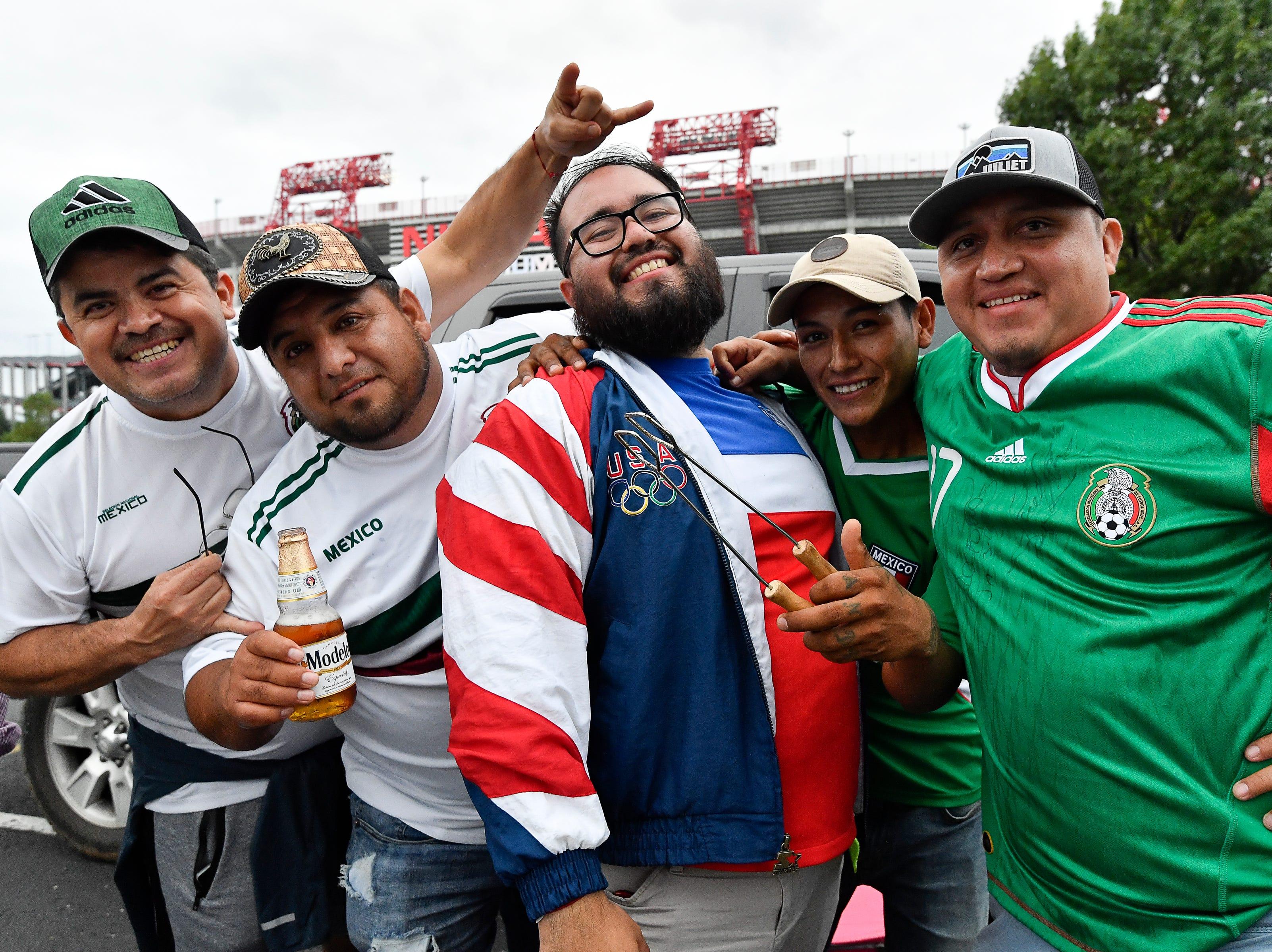 Soccer fans Jose Calderon, Jose Sanchez, Dante Martinez, Jesus Vargas and Christian Jimenez get ready for the USA vs. Mexico soccer match at Nissan Stadium Tuesday, Sept. 11, 2018, in Nashville, Tenn.