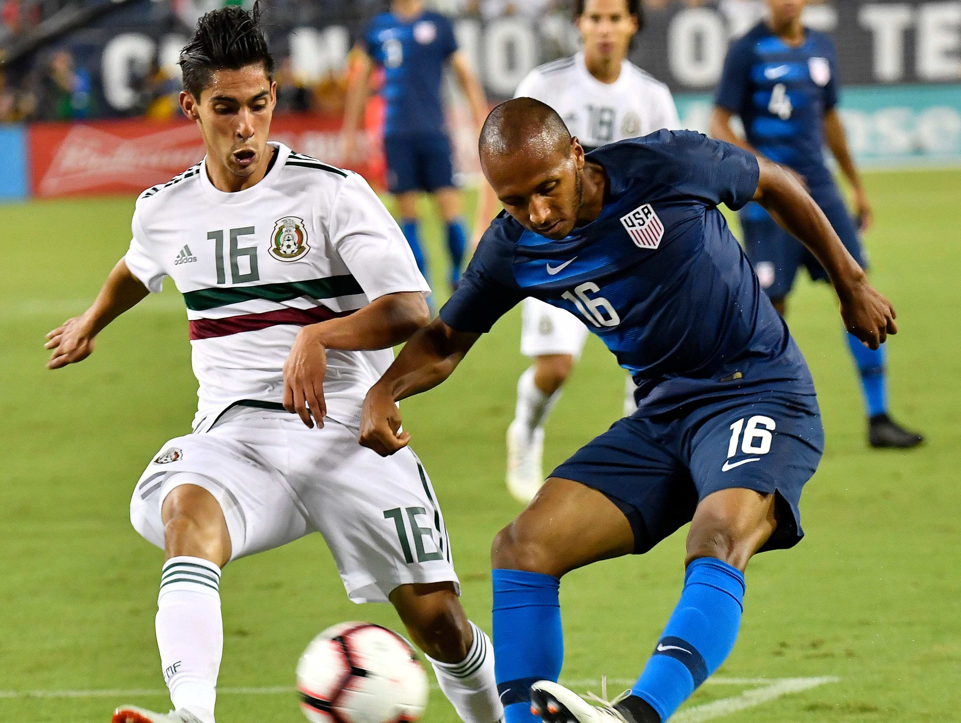 USA midfielder Julian Green (16) kicks the ball past Mexico midfielder Erick Aguirre (16) during the second half of their game at Nissan Stadium Tuesday, Sept. 11, 2018, in Nashville, Tenn.