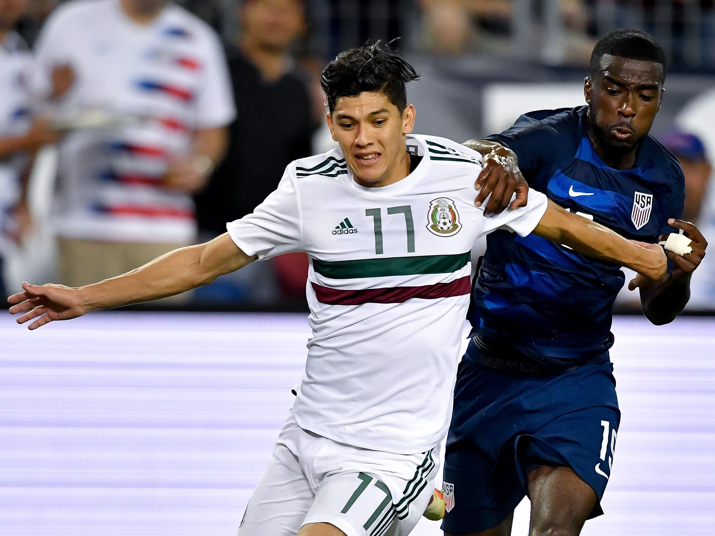 Mexico defender Gerardo Arteaga (17) battles USA defender Shaq Moore (19) during the first half at Nissan Stadium in Nashville, Tenn., Tuesday, Sept. 11, 2018.