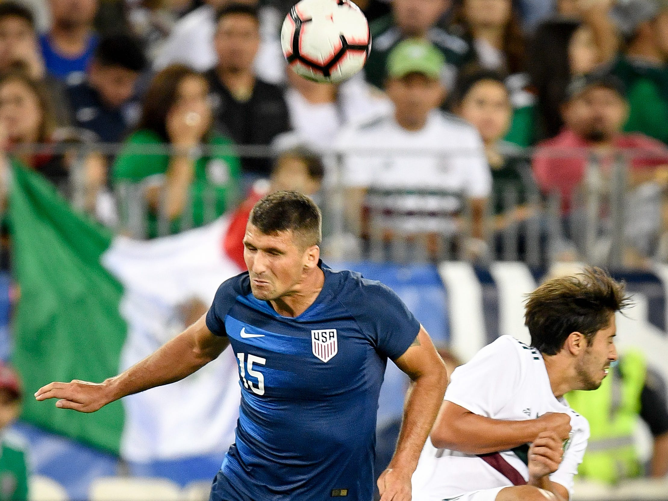 USA defender Eric Lichaj (15) battles Mexico defender Jose Abella (19) during the second half at Nissan Stadium in Nashville, Tenn., Tuesday, Sept. 11, 2018.