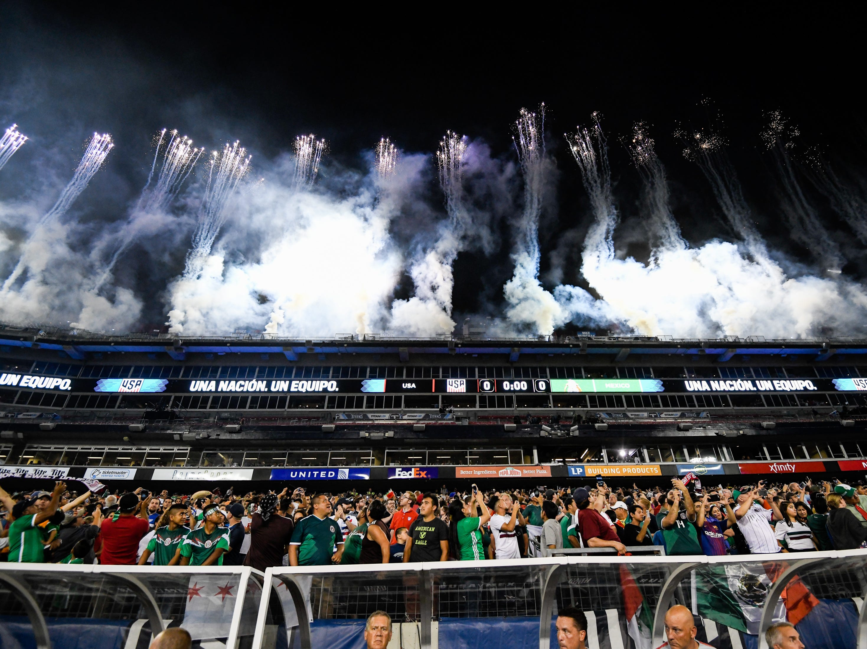 Fireworks launch behind the fans before the game between USA and Mexico at Nissan Stadium in Nashville, Tenn., Tuesday, Sept. 11, 2018.