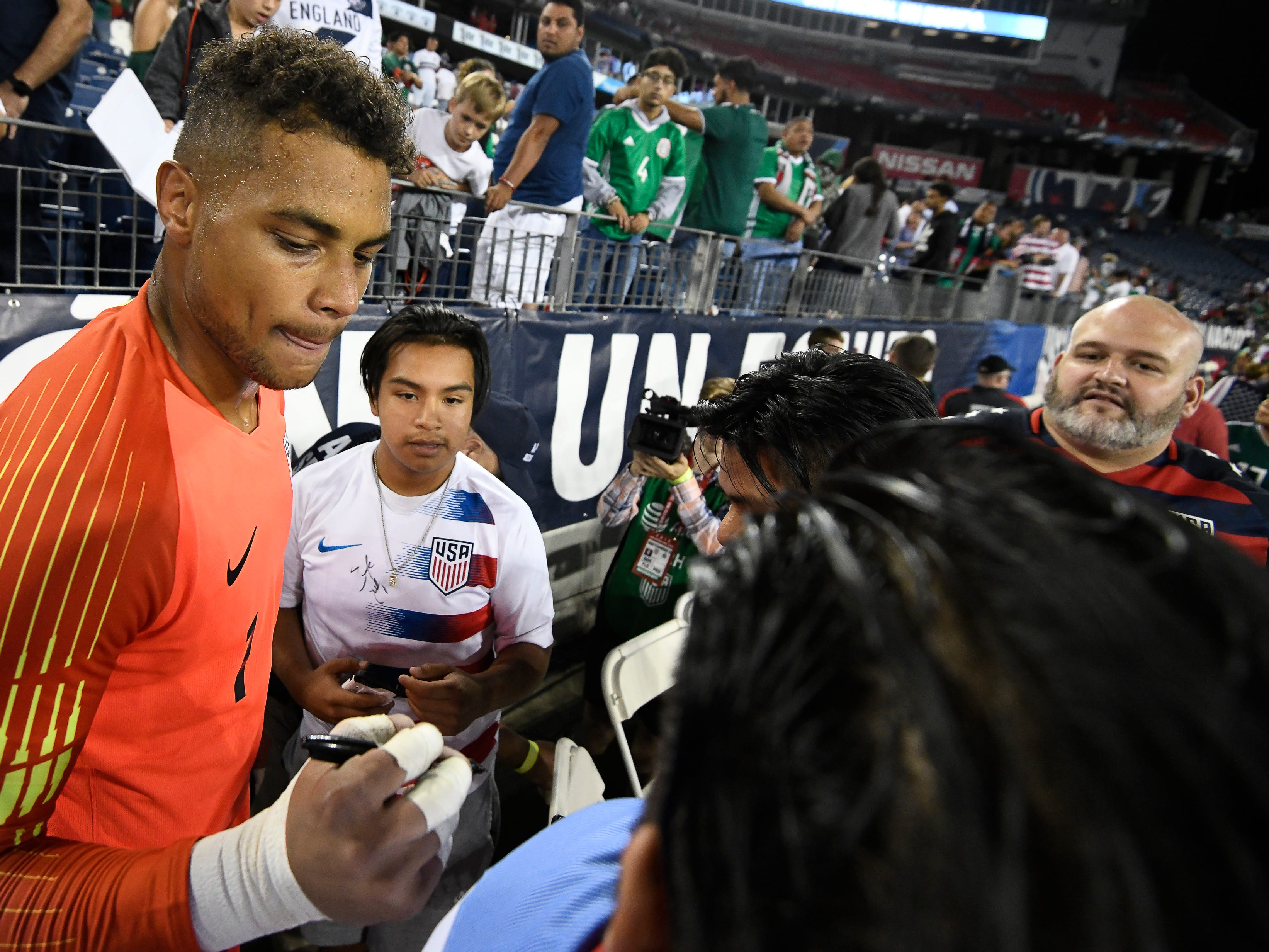 USA goalkeeper Zack Steffen (1) signs autographs for fans after their 1 to 0 victory over Mexico at Nissan Stadium Tuesday, Sept. 11, 2018, in Nashville, Tenn.