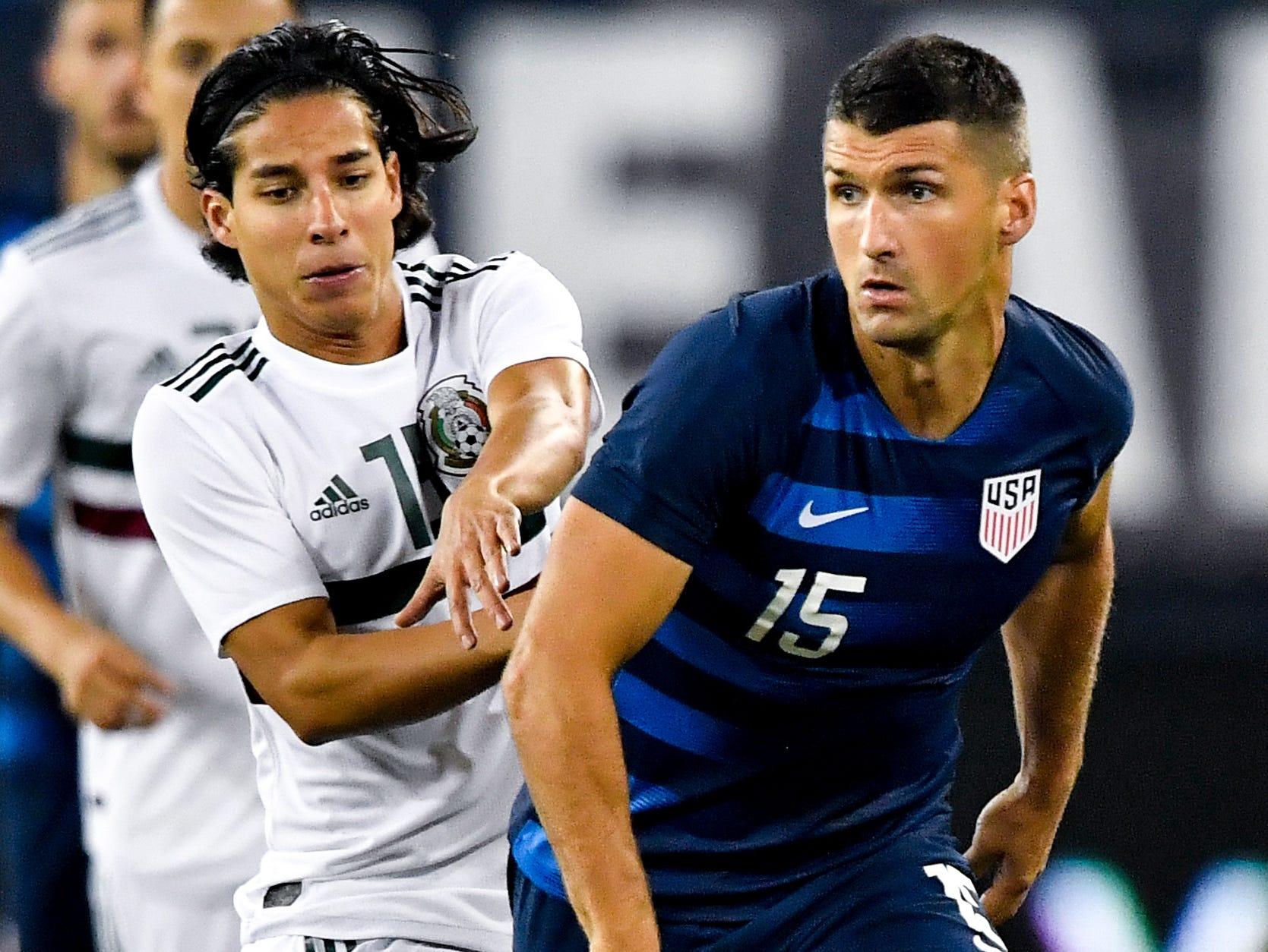 USA defender Eric Lichaj (15) advances past Mexico midfielder Diego Lainez (18) during the first half at Nissan Stadium in Nashville, Tenn., Tuesday, Sept. 11, 2018.