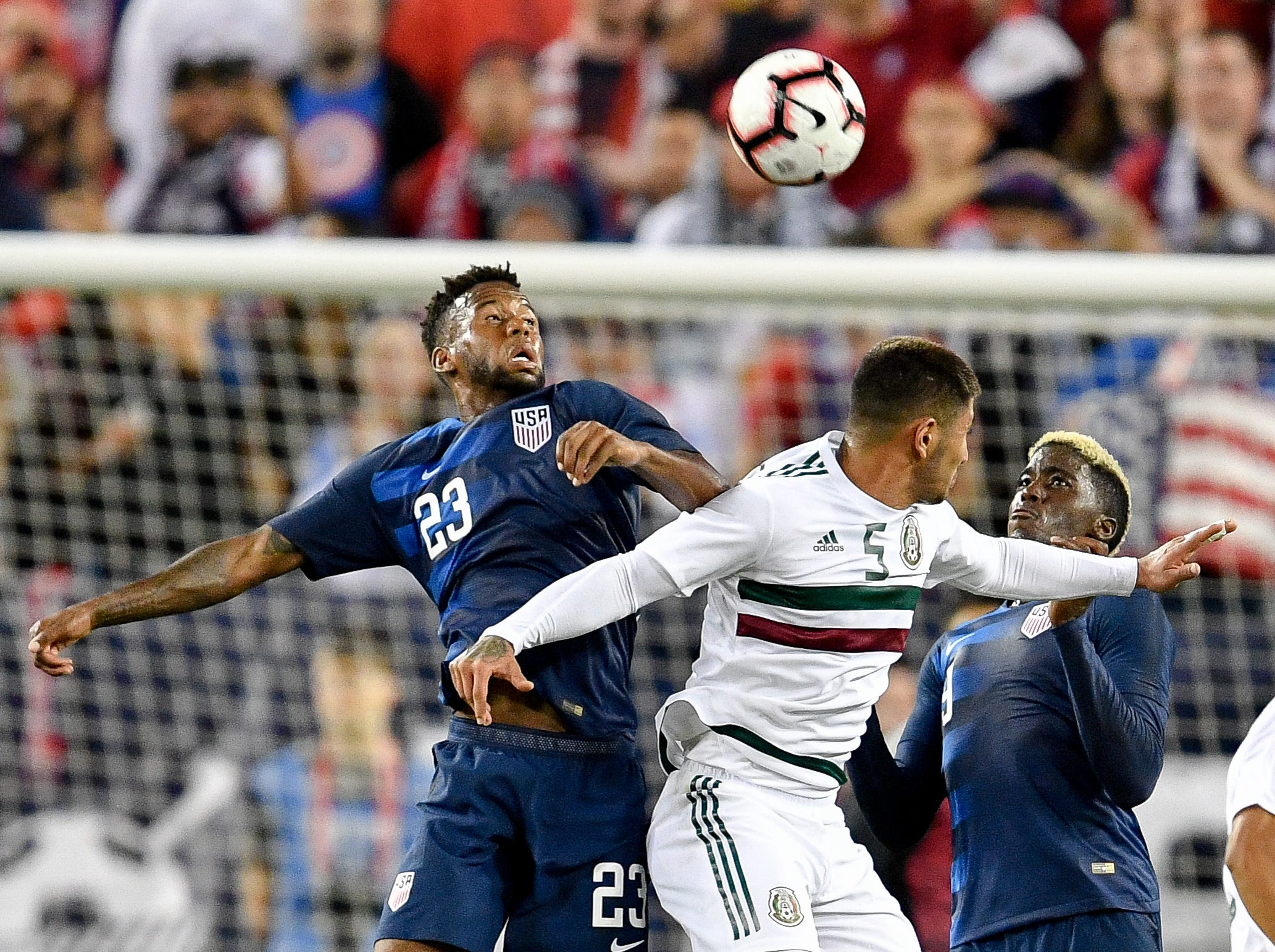 USA midfielder Kellyn Acosta (23) leaps for the ball with Mexico midfielder Victor Guzman (5) during the second half at Nissan Stadium in Nashville, Tenn., Tuesday, Sept. 11, 2018.