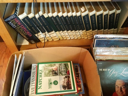 Selling a set of old encyclopedias at a garage sale would be a challenge.