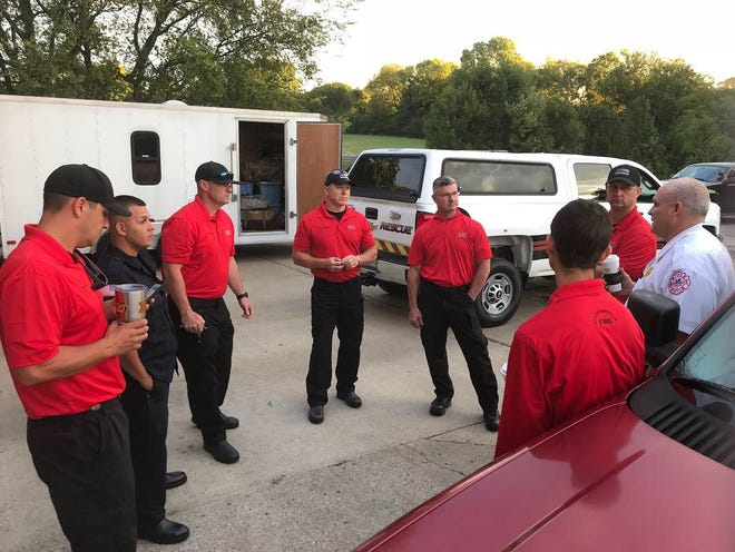 Hendersonville Fire Chief Scotty Bush talks with members of the swift water team before they head to South Carolina to help during Hurricane Florence.