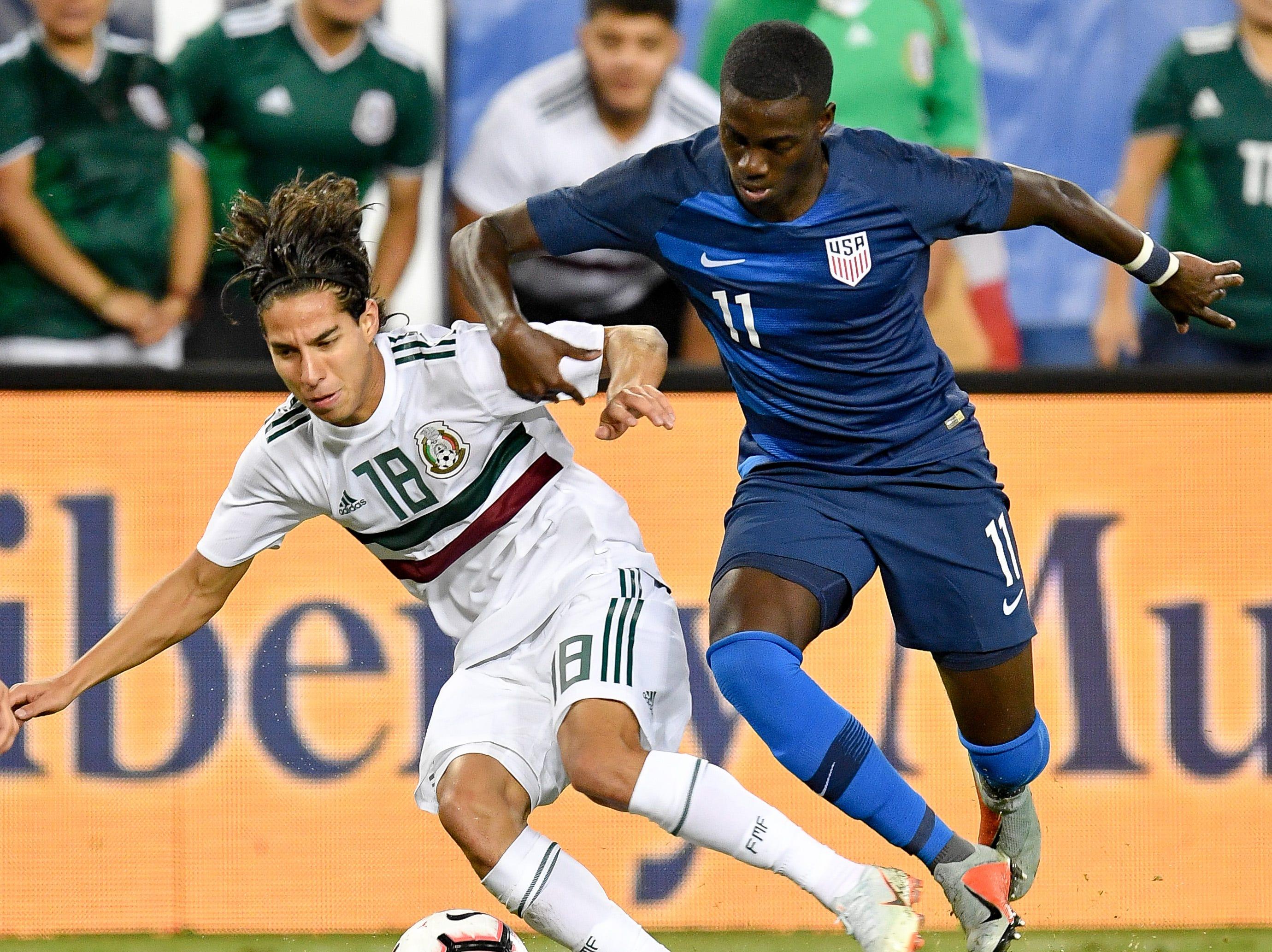 Mexico midfielder Diego Lainez (18) battles USA midfielder Tim Weah (11) during the second half at Nissan Stadium in Nashville, Tenn., Tuesday, Sept. 11, 2018.