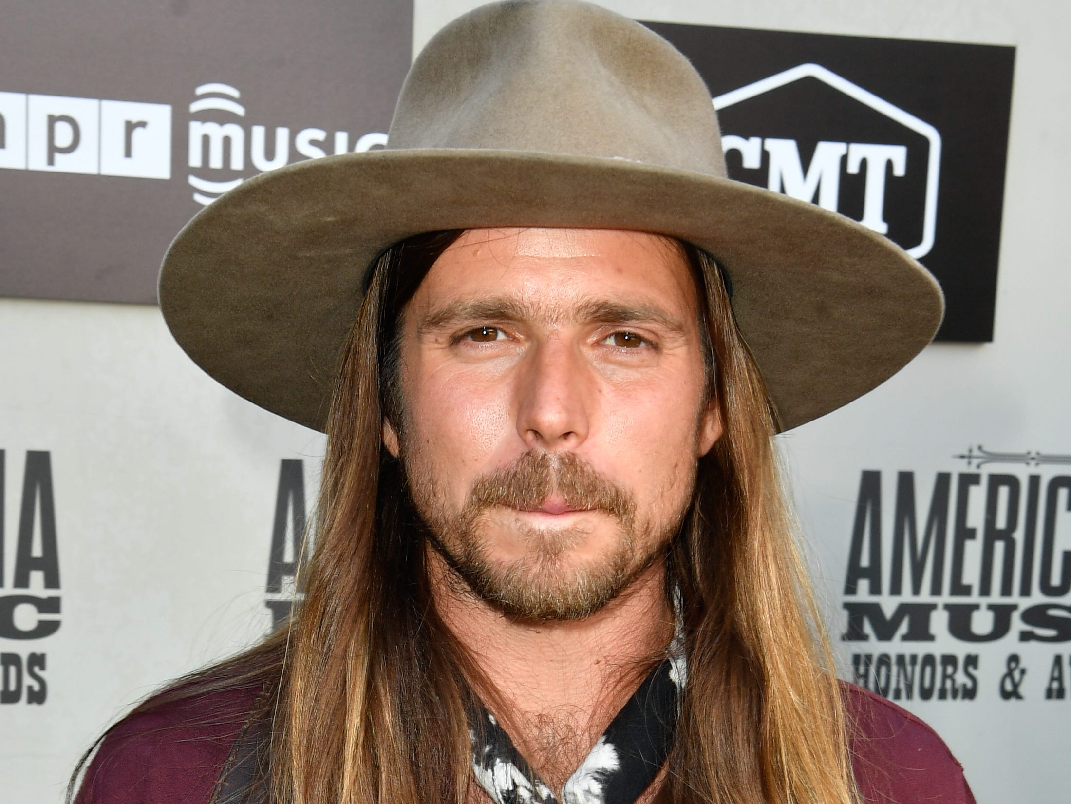 Lukas Nelson poses on the red carpet before the 2018 Americana Honors and Awards show at the Ryman Auditorium in Nashville, Tenn., Wednesday, Sept. 12, 2018.
