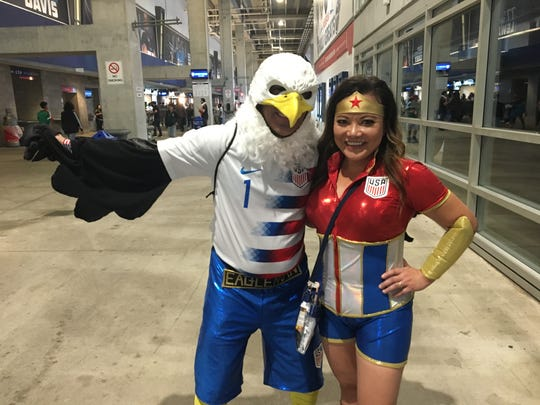 """Marcus Cranston and Lila Asnai also known as """"Eagleman & Wonderfan"""" pose for a photo before the start of the U.S. Men's National Team's Soccer match against the Mexico National Soccer Team on Sept. 11, 2018."""
